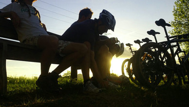 Bicyclists-sitting-on-the-bench-in-twilight-1